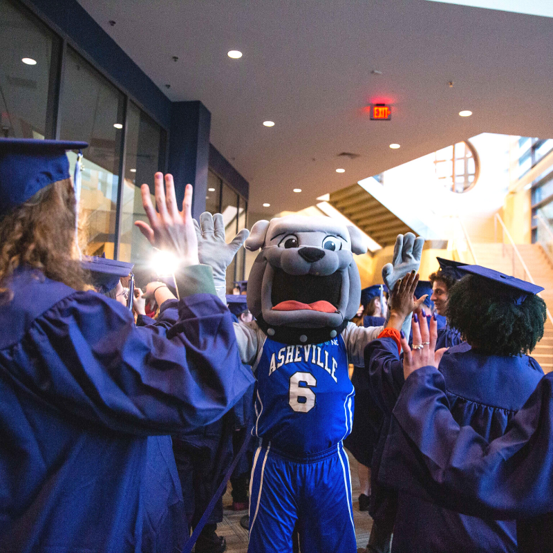 Photo of Rocky the Mascot and Graduates
